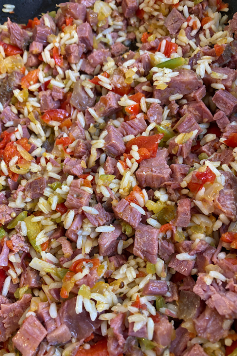Corned Beef Cabbage Rolls filling made of rice, corned beef, chopped celery, onion, and bell pepper