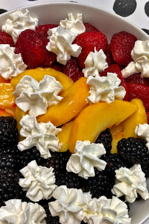 peach berry citrus fruit bowl with whipped cream